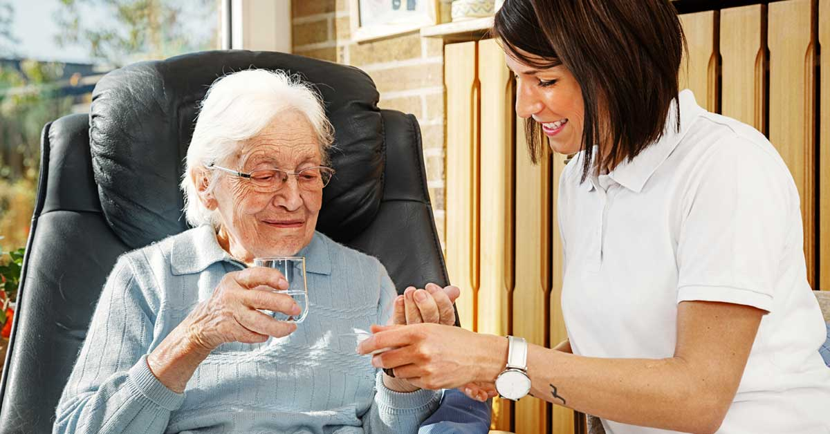 Home Care Aide Assisting With Medication