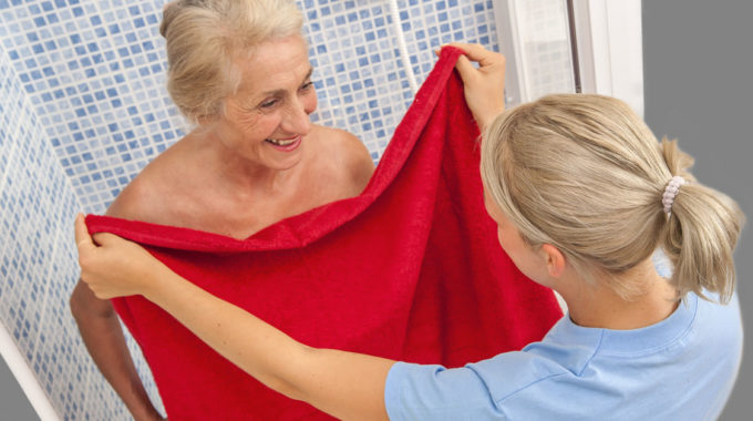 Home Care Aide Helping A Senior With Bathing