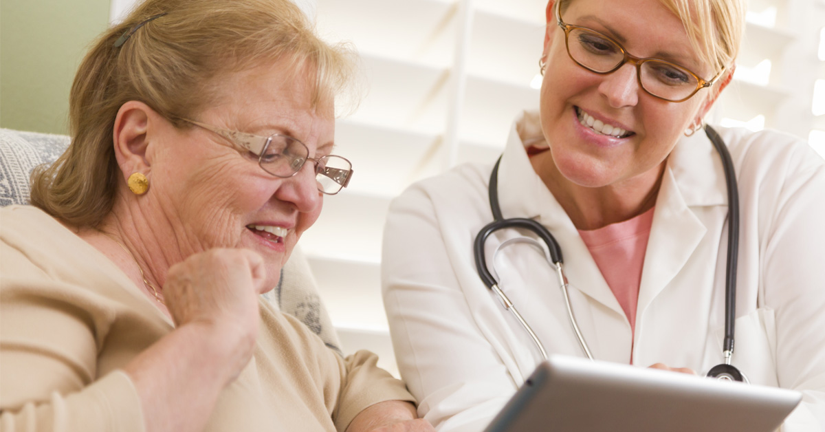 Home Health Worker Helping Senior With Video Telemedicine